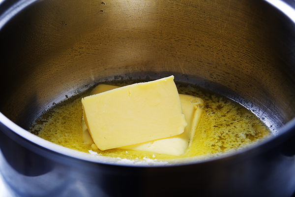 Butter melting in a pan on the stove
