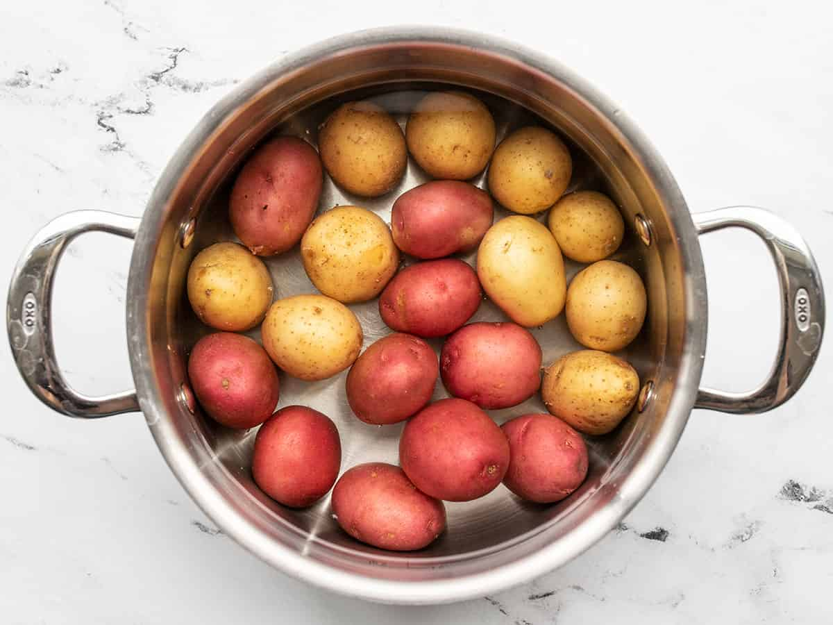 Baby potatoes in a pot with water