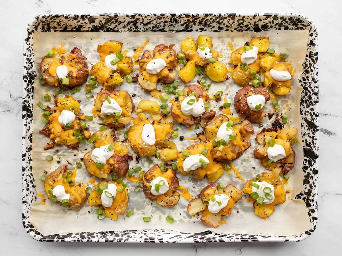 Final smashed potatoes topped with sour cream and green onion