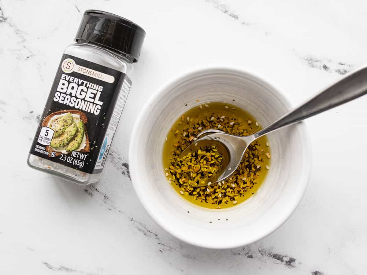 Olive oil and everything bagel seasoning in a bowl
