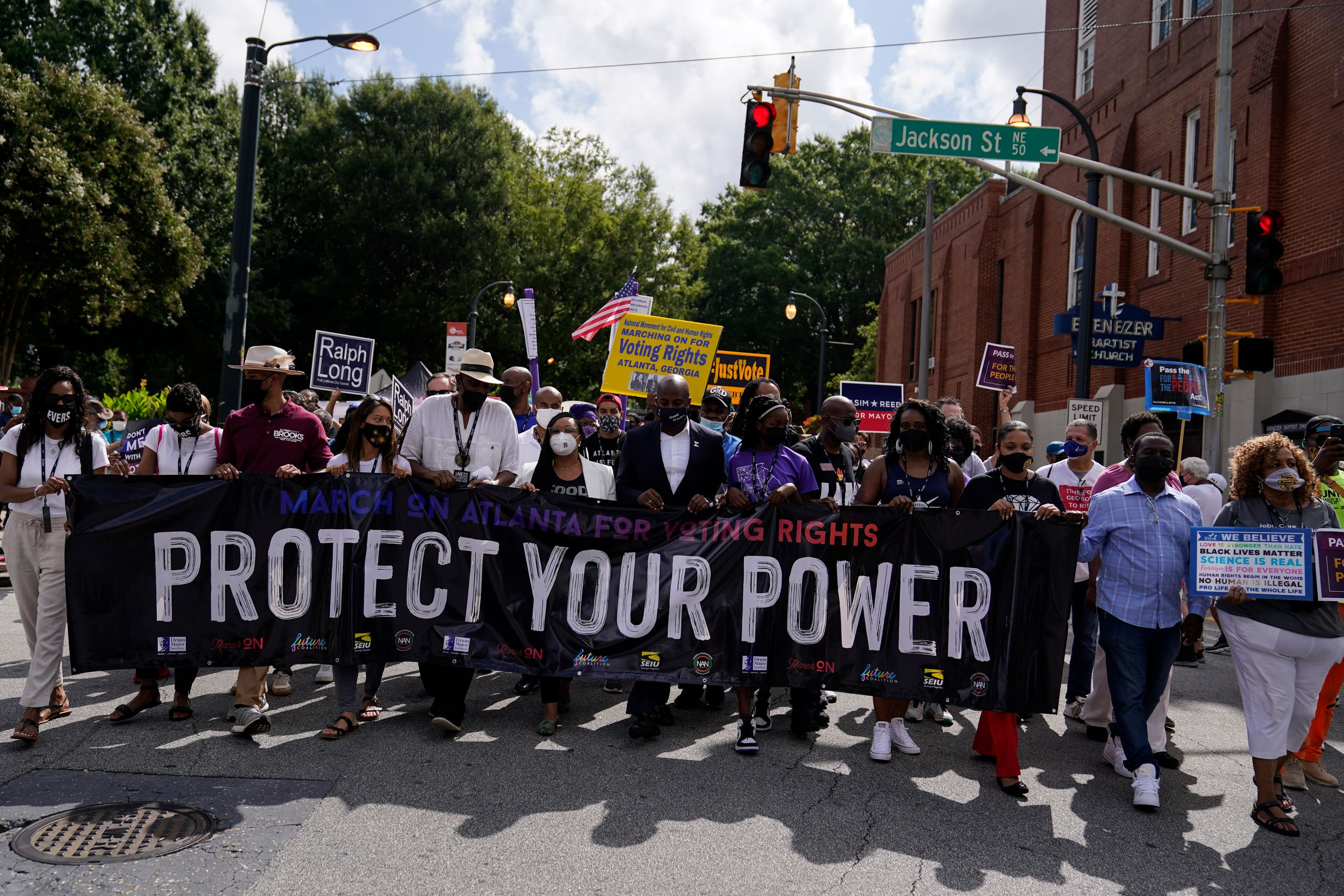 Atlantans demonstrate in favor of federal voting rights legislation on Aug. 28, the 58th anniversary of the March on Washingt